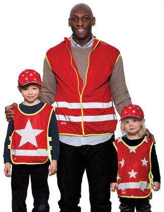 Röda reflexvästar med stjärna, stjärnor och för pedagoger.